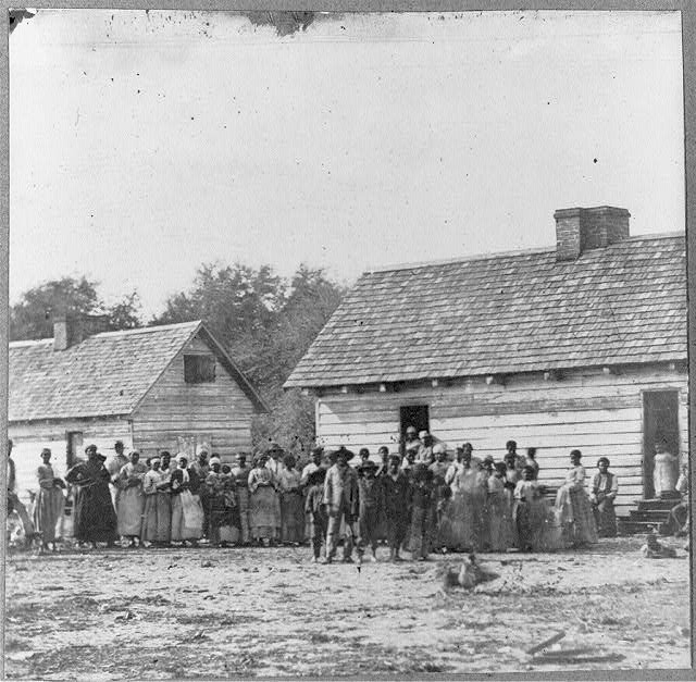 [Large group of slaves(?) standing in front of buildings on Smith&#39;s Plantation, Beaufort, South Carolina]