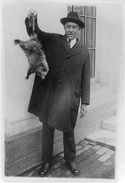 [Danridge Epps of Natural Bridge, Virginia, holding 6-pound opossum which was presented to Pres. Coolidge]