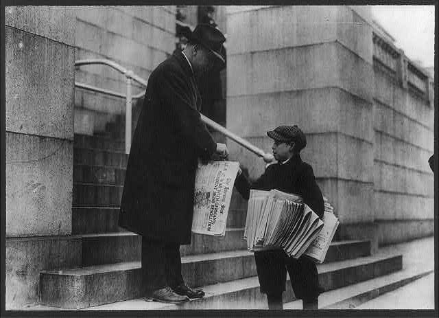 "[Man buying The Evening Star from newsboy, Washington, D.C. - headline reads ""U.S. at War with Germany""]"