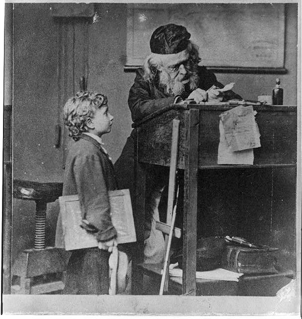 [Old school teacher (sharpening feather pen?) and pupil]