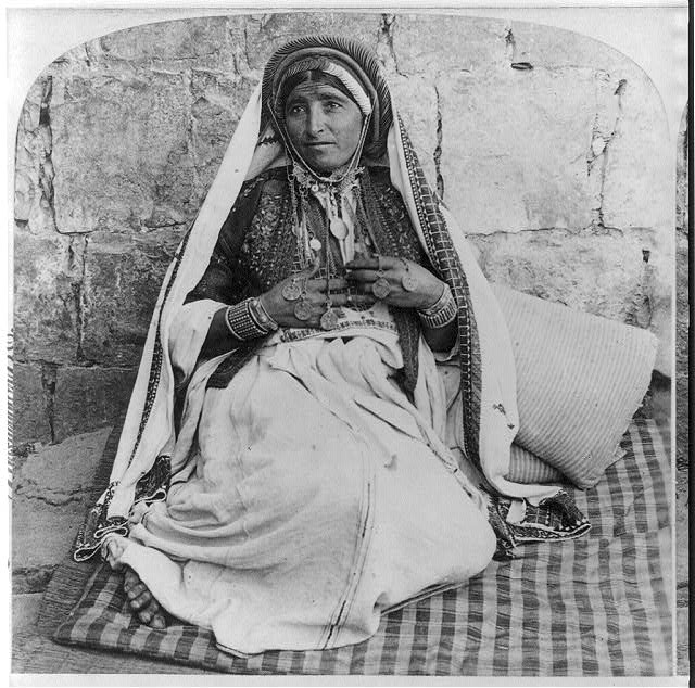 A woman of Ramah and her ornaments, Palestine
