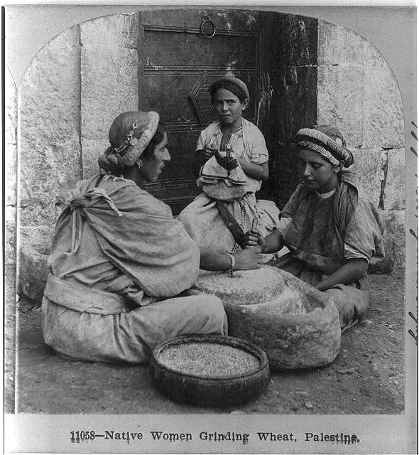 Native women grinding wheat, Palestine