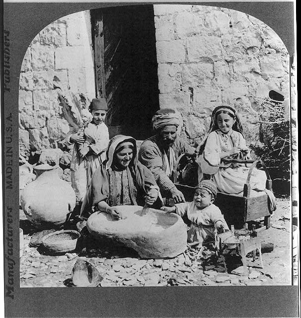 Grinding wheat at native home - Palestine