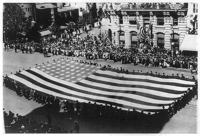 [Huge flag being carried by a large group of men in a G.A.R. parade in Washington, D.C.]