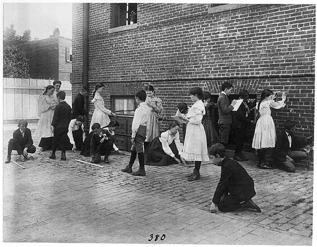 [Students of 8th Division school using rulers, yardsticks, and measuring tape in school yard, Washington, D.C.]