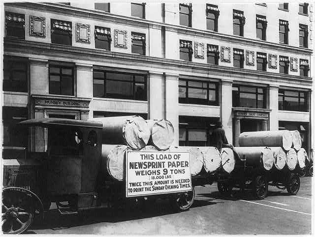 Truck loaded with newsprint paper for the Sunday Evening Times parked in front of the Munsey Building, Washington, D.C.