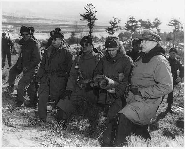 [Douglas MacArthur at the front lines above Suwon, Korea, accompanied by Courtney Whtney, Matthew B. Ridgway, William B. Kean, and others]