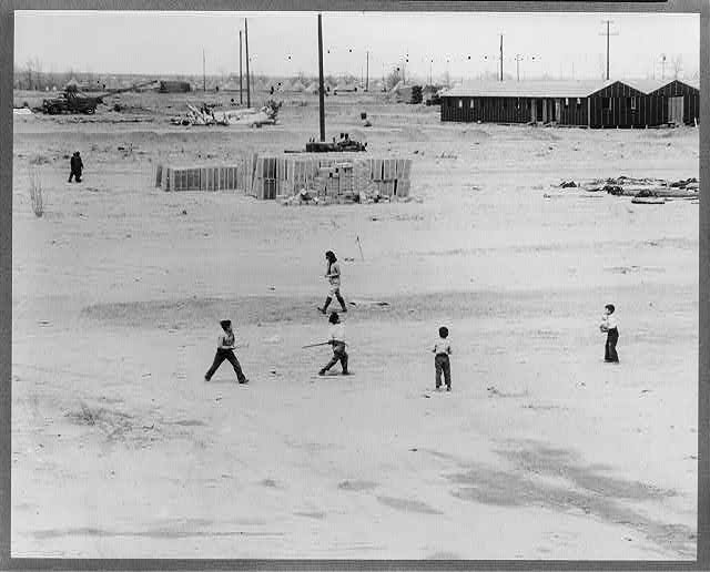 Manzanar, Calif., April 1942 - boys starting a ball game soon after their arrival at Manzanar, a War Relocation Authority center for the evacuees of Japanese ancestry from certain West Coast areas