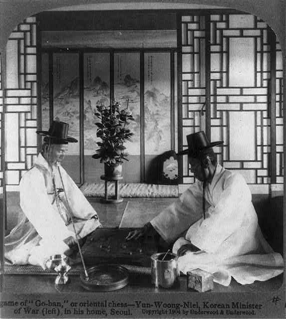 "A game of ""Go-ban,"" or oriental chess - Yun-Woong-Niel, Korean Minister of War (left) in his home, Seoul"