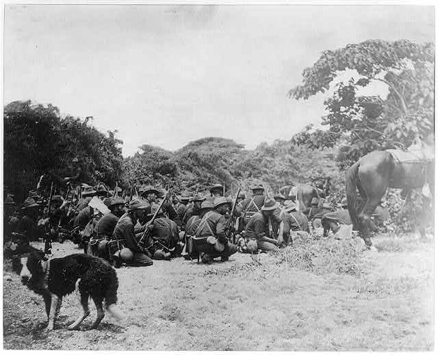 Sixth Infantry in San Juan creek bottom under Spanish fire from San Juan Hill, July 1, 1898