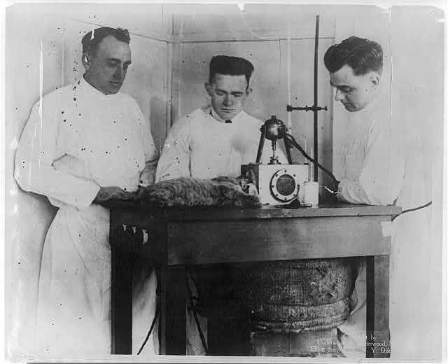New ether - a great medical discovery. ... Dr. J.H. Cotton, the inventor, is seen experimenting with the ether in a Boston hospital [on cat; with 2 other men] 1920