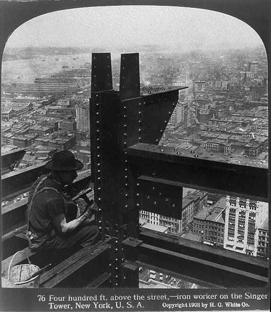 Four hundred ft. above the street - iron worker on the Singer Tower, New York, U.S.A.