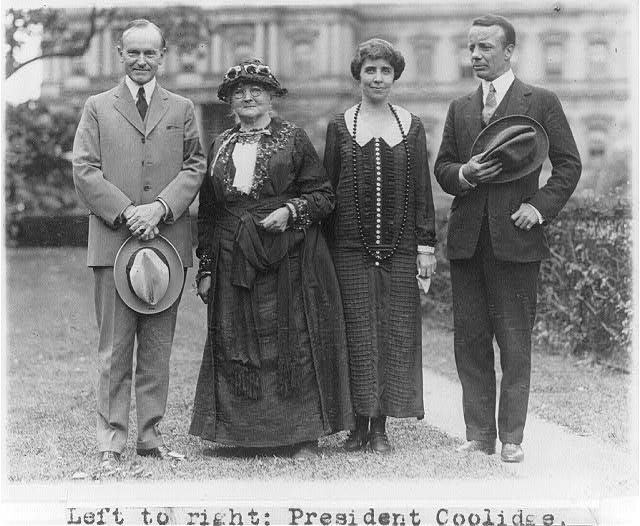 "[President Coolidge, ""Mother"" Jones, Mrs. Coolidge and Theodore Roosevelt, Jr., posed standing on White House lawn.]"