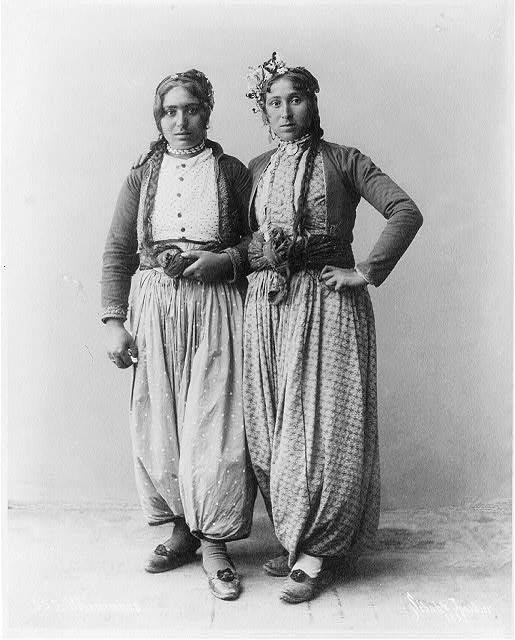 Two gypsy women standing, full lgth., Palestine