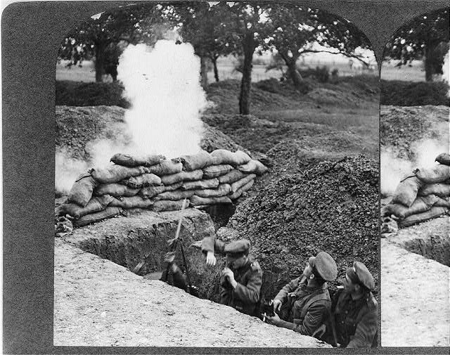 [Three British soldiers in trench under fire during World War I]
