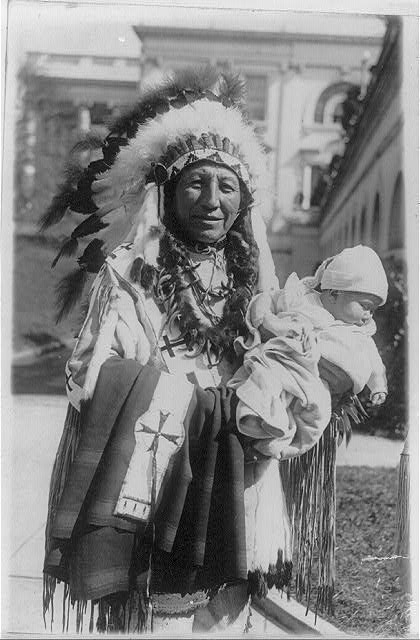 Chief Spotted Crow of the Sioux tribe of Pine Ridge, S.D. and his five months old granddaughter, Lena Lou White House, who was named by Vice President Curtis a few days ago