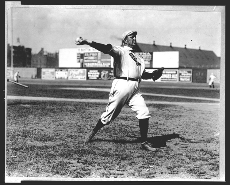 [Cy Young, Boston AL, full-length portrait, standing, facing right, throwing baseball]