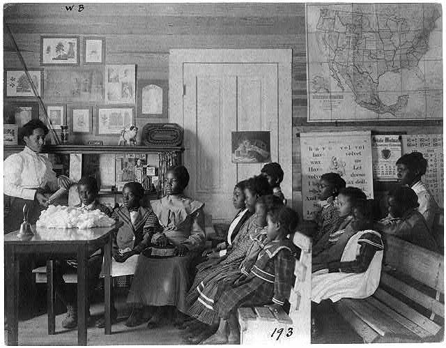 [African American children and teacher in classroom studying corn and cotton, Annie Davis School, near Tuskegee, Alabama]