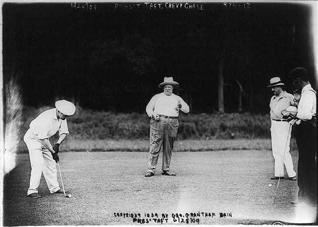 [Pres. William H. Taft playing golf, Chevy Chase Country Club, 3 other men in picture, 1909 June 28]