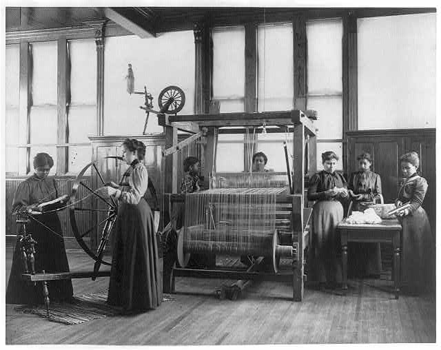[African-American women weaving rug in home economics class at Hampton Institute, Hampton, Va.]