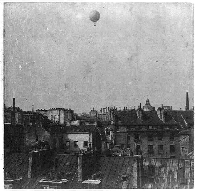 [Captive balloon of Henri Giffard over Paris, 1878; high above rooftops]