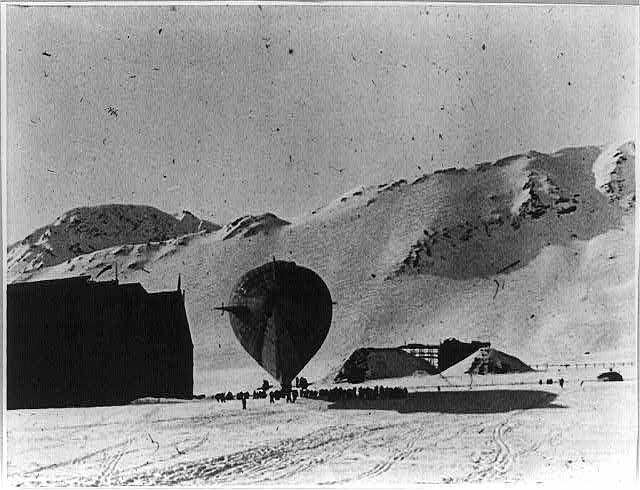 [Airship Norge, used in Roald Amundsen's polar flight in 1926, being brought out of hangar, Kings Bay, Spitzbergen, Norway]