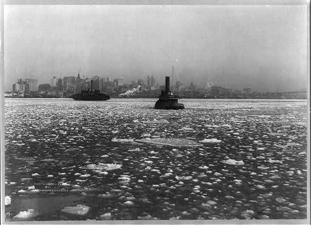 [Tugboats and ferry on icy river, with New York City in backgrd.]