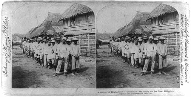 A company of Filipino soldiers - prisoners of war coming into Las Pinas, Philippines