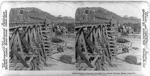Bridge destroyed by insurgents, later repaired by American Engineers, Bamban, Luzon, P.I.
