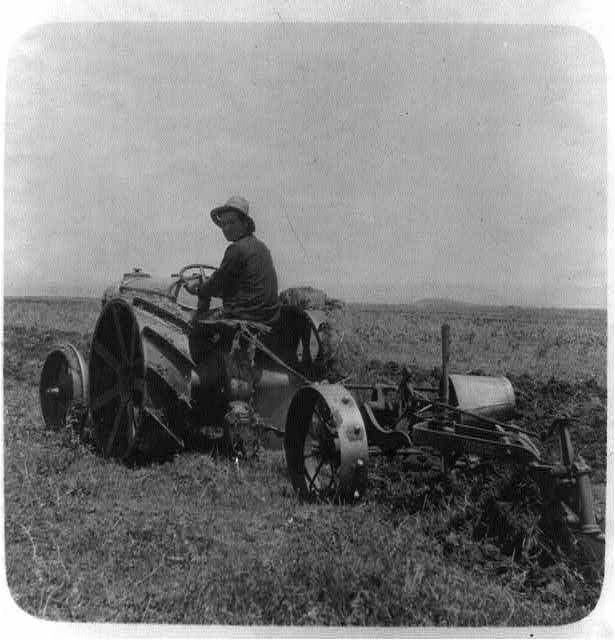 "[Tractor plowing in the ""Emek""]"