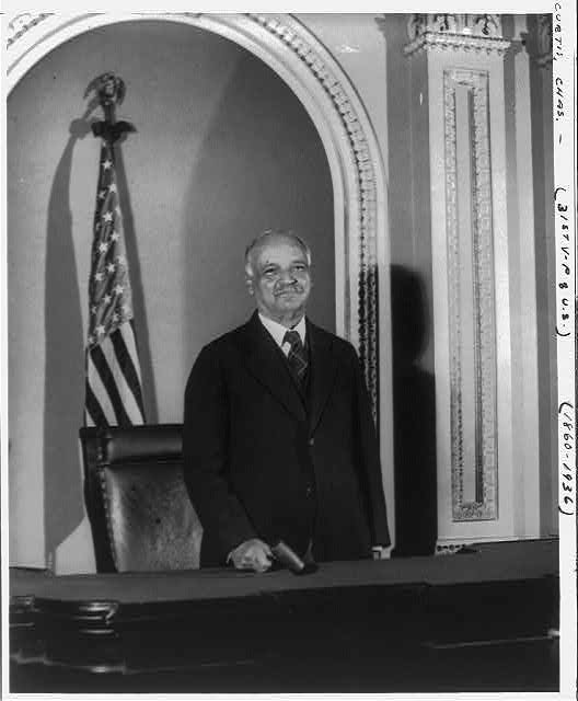 [Charles Curtis, 31st vice president, half-length portrait, facing front, standing on the Senate rostrum in the U.S. Capitol]