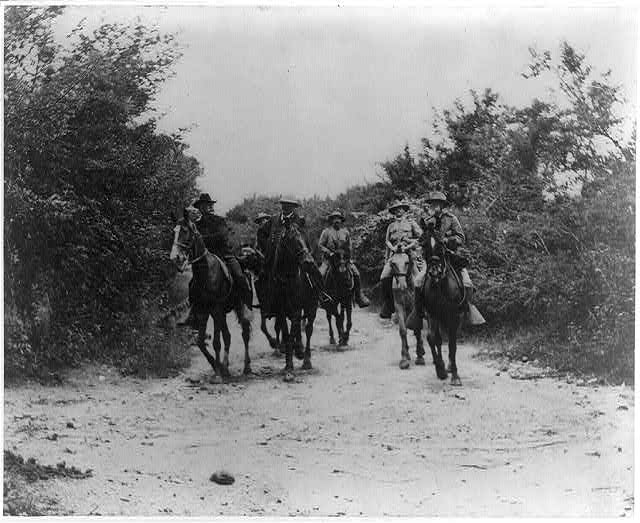 Genral Miles, Shafter, Wheeler [and 3 other soldiers on horeback] returning from the conference with Genral H. Toral which resulted in the surrender of the Province of Santiago de Cuba