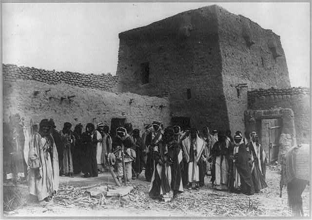 Arabia. Shiek's fortress in the desert [with group of Arabs posed.] (Alois Masil)