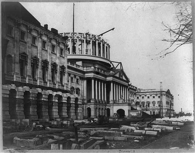 [Capitol construction, east front looking north, dome in progress]