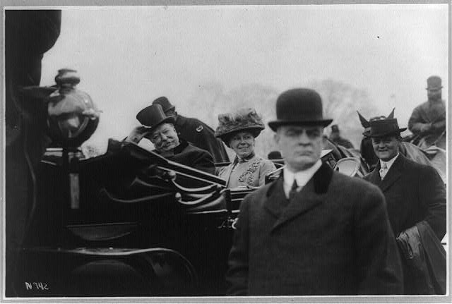 Pres. and Mrs. Taft smiling at crowds on way to the White House