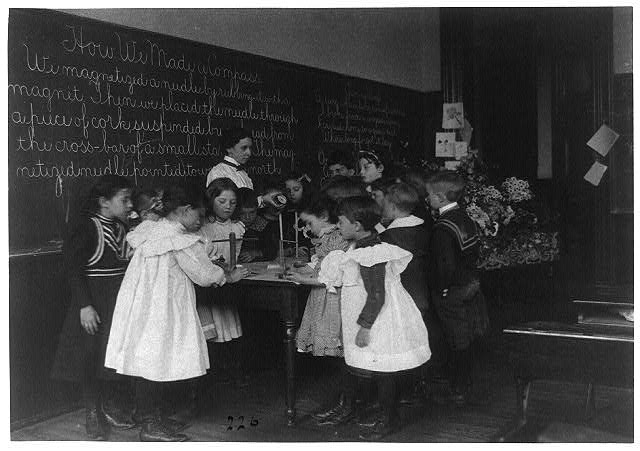 [Children in school in Washington, D.C. - learning how a compass is made]