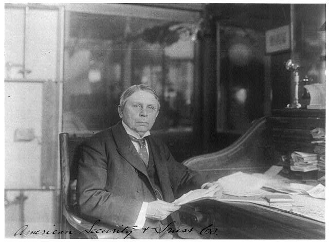 [Man (banker?) seated at desk at American Security and Trust Co., Washington, D.C.]