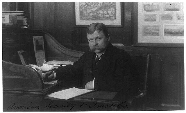 [Man (banker?) seated at desk in American Security and Trust Co., Washington, D.C.]