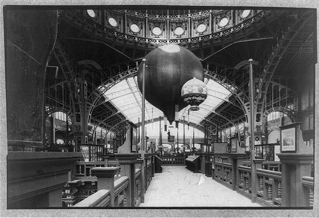 [Interior of Paris Exposition building showing two balloons]