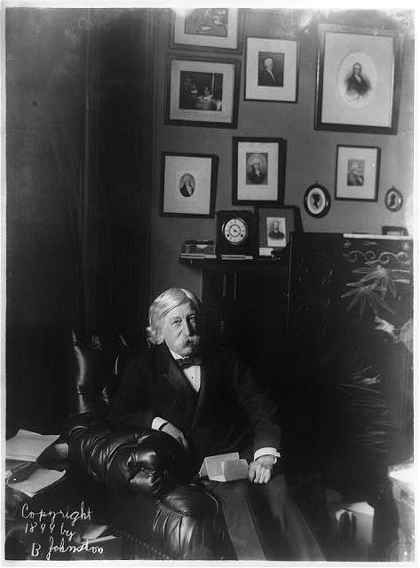 [Melville Weston Fuller, Chief Justice, Supreme Court, three-quarter length portrait, seated, facing right]