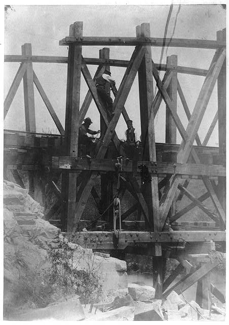 [Military railroad operations in northern Virginia: two men boring holes in bridge trestles and man with Haupt's Torpedo]