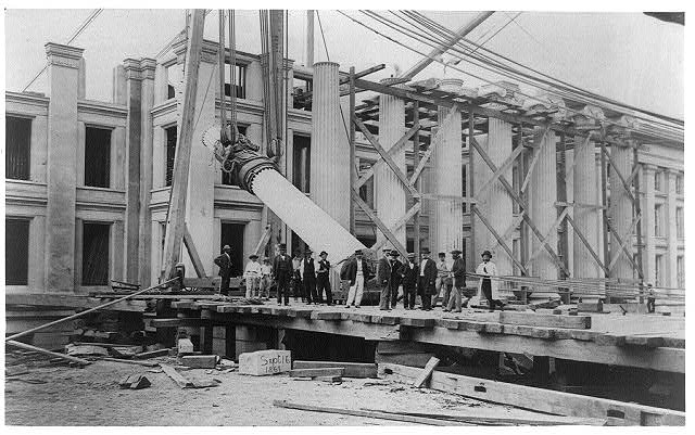 [Construction of Treasury Building, Washington, D.C.: Men standing in front; column being raised into position, Sept. 16, 1867]