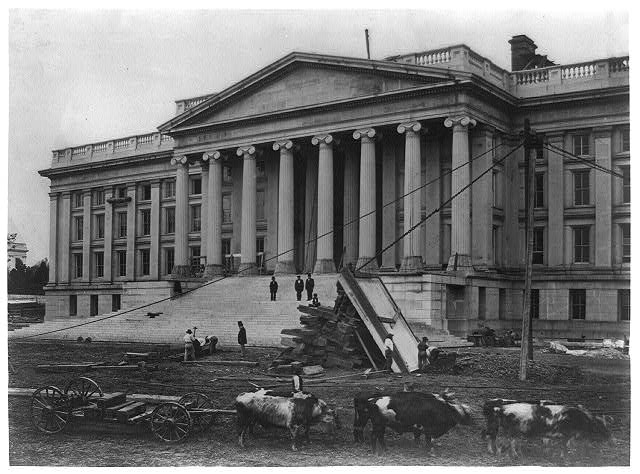 [Construction of Treasury Building, Washington, D.C. With oxen in foreground on south side]