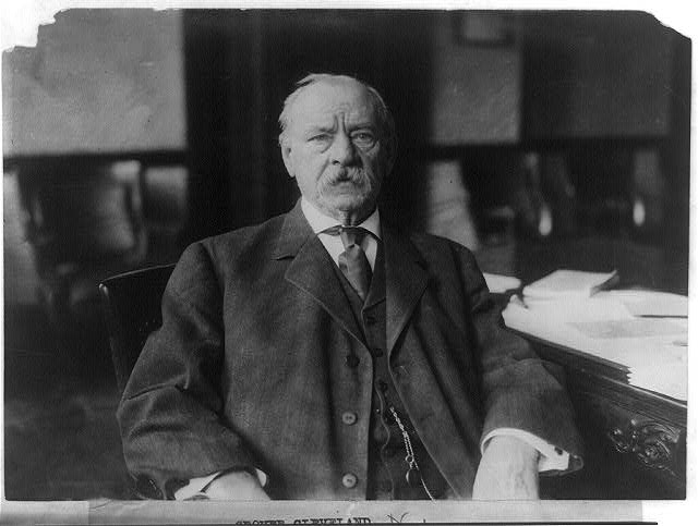 [Grover Cleveland, half-length portrait, seated at desk, facing front]