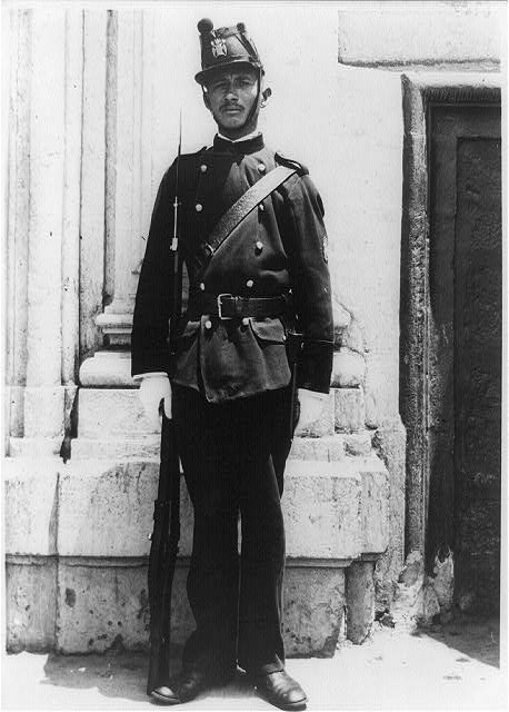 Mexico City, Mexico--Feb. 10, 1913--Soldier guarding National Palace