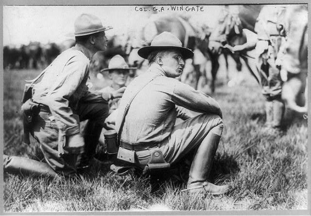 Col. G.A Wingate, seated on ground, 1913