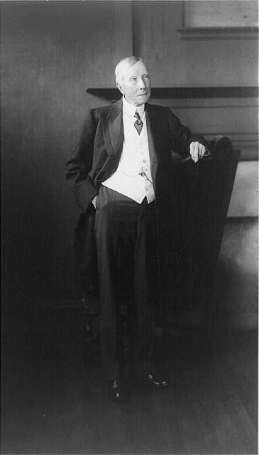 [John Davison Rockefeller, full-length portrait, standing, facing right]