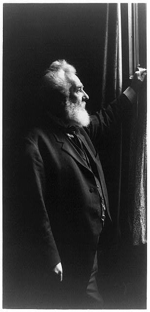 [Alexander Graham Bell, three-quarter length portrait, standing, facing right, by window]
