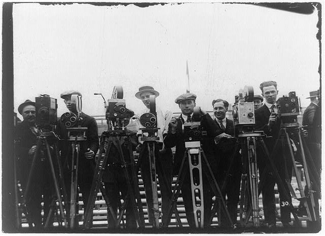 [Newsreel cameramen with cameras at the Dempsey-Carpentier boxing match at Boyle's Thirty Acres, Jersey City, N.J.]