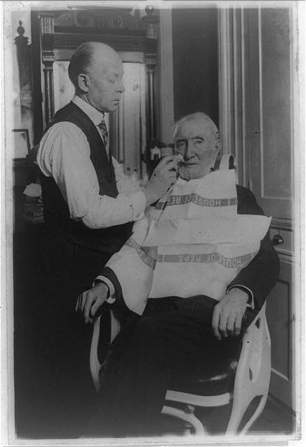Uncle Joe Cannon getting one of his last congressional shaves. Bert Broden has been Uncle Joe's barber for the past twelve years